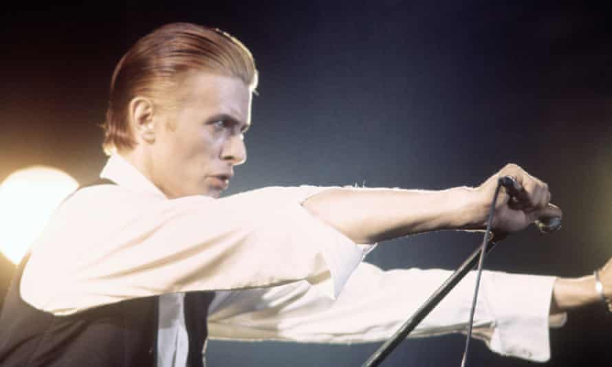 David Bowie performs on the Station to Station tour in 1976.