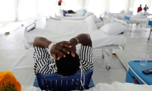 A covid-19 patient reacts after being tested inside a field hospital built on a soccer stadium in Machakos.
