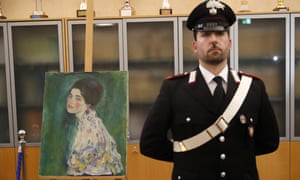 A carabiniere guards Gustav Klimt's Portrait of a Lady at a press conference in Piacenza, Italy.