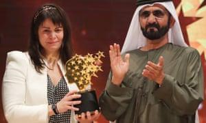 Maggie MacDonnell receives the Global Teacher Prize from Sheikh Mohammed bin Rashid al-Maktoum.