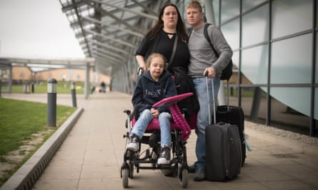 Emma Appleby, Lee Moore and their daughter Teagan at London Southend airport, Essex.