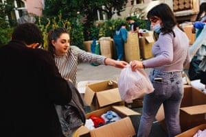 Volunteers sort through donated clothes