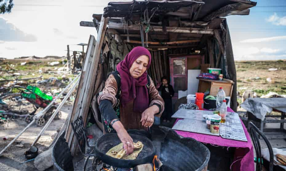 Aisha Quraishi in front of her tent where she sells bread