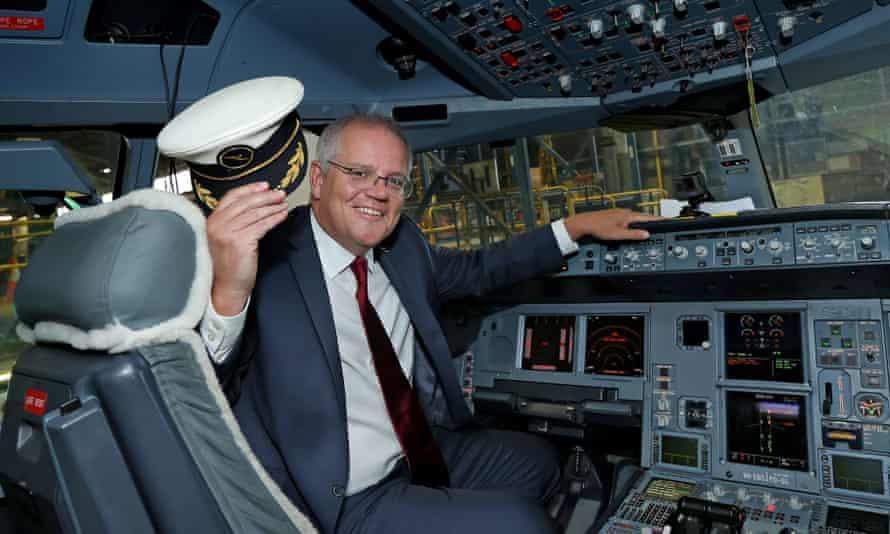 scott morrison in the cockpit of a plane