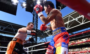 Jeff Horn trades blows with Manny Pacquiao intheir WBO World Welterweight title boxing match at Suncorp Stadium in Brisbane on Sunday.