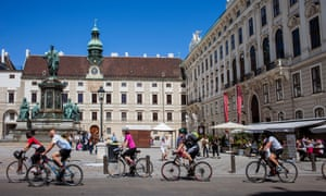 Cyclists in front of the Hofburg palace, Vienna.