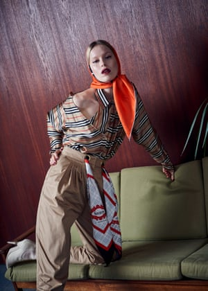 Stripe silk shirt, £1,250, trousers with archive scarf tie detail, £850, palladium and gold plated hoop earrings, price upon request, satin peep toe ankle boots, price upon request, and silk head scarf, from a selection, all burberry.com