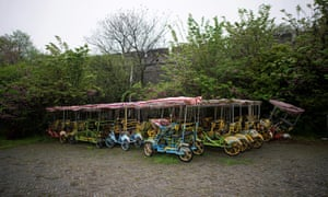 Vehicles for tourists are seen parked at an ancient city wall in Jingzhou after the lockdown was eased in Hubei.