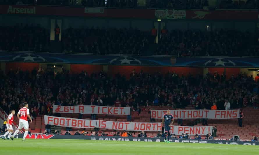 Bayern Munich fans display a banner protesting about the high price of tickets before they take their seats at the Emirates.