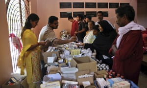 Volunteers give medicine to people in a relief camp on the outskirts of Kochi, Kerala.