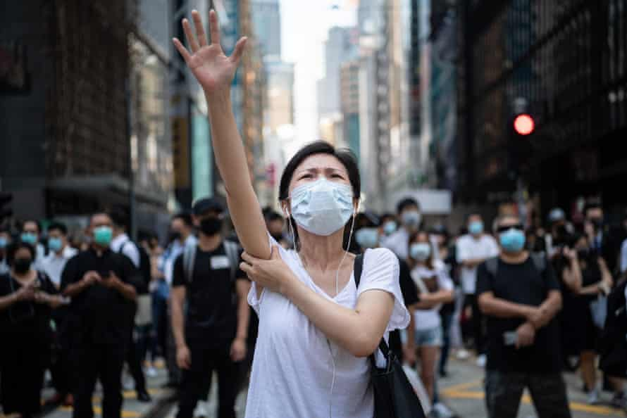 People protest against a government ban on face masks in Hong Kong on 4 October 2019.