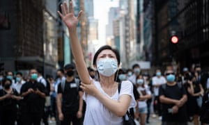People protest against the ban on face masks in central Hong Kong.