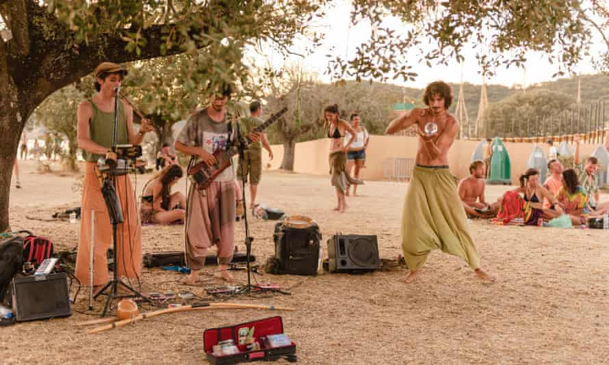 Musicians performing at BOOM Festival, an eco-friendly music festival in Portugal