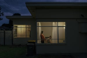 A pregnant women and a man inside a home.