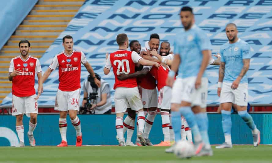 The Arsenal players celebrate after Pierre-Emerick Aubameyang opened the scoring.