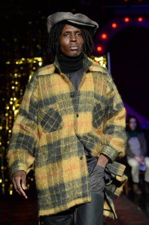 For his fourth collection, this time at Bethnal Green Working Men's Club, Nicholas Daley paid homage to famed producer Lee Scratch Perry by combining heritage plaid with denim and knitwear .