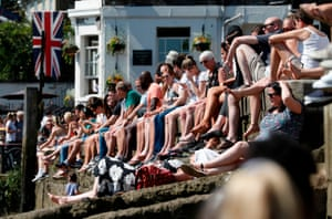 People line the banks of the River Thames in Richmond.