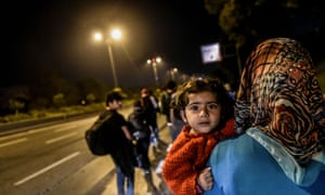 Refugees in Turkey walk on a highway towards Edirne, close to the Greek border, on 21 September.