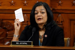 House Judiciary Committee member Pramila Jayapal (Democrat of Washington State) holds up a copy of the US Constitution as she votes to pass articles of impeachment against Donald Trump