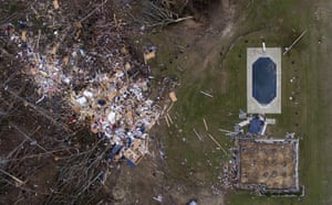 Debris from a home litters a yard the day after a tornado blew it off its foundations, seen on the bottom right of the image. Beauregard, US