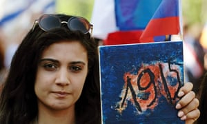 A woman holds a placard bearing the date '1915' during a march on Tuesday in Yerevan.