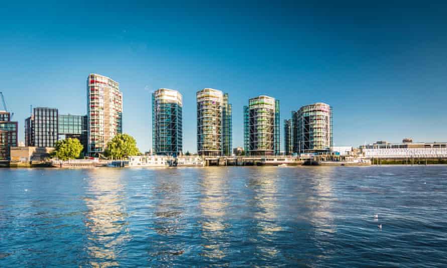 New housing emerging on the riverside at Nine Elms in Vauxhall, London, UK.