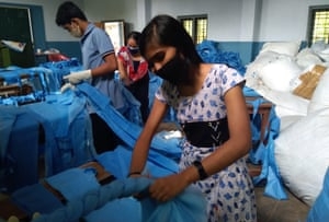 Stduents at a Kerala school making mattresses for the local Covid care centre.