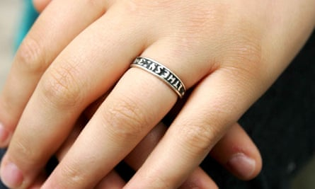 A woman wearing an abstinence ring