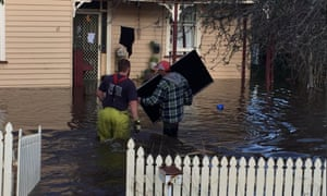 Residents try to salvage property in Huonville, Tasmania