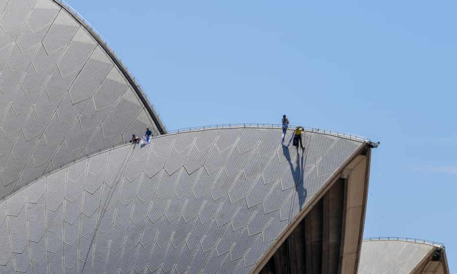 The activists who scaled the Sydney Opera House have accused Australia of being a 'world leader in cruelty' for its treatment of refugees on Manus Island