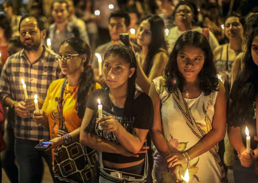 People pay tribute to human rights defenders murdered in Colombia, in Medellin on 31 January, 2018.