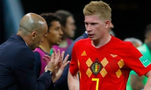 Belgium's Roberto Martinez (left) briefs his false nine, Kevin De Bruyne, during the victorious quarter-final against Brazil.