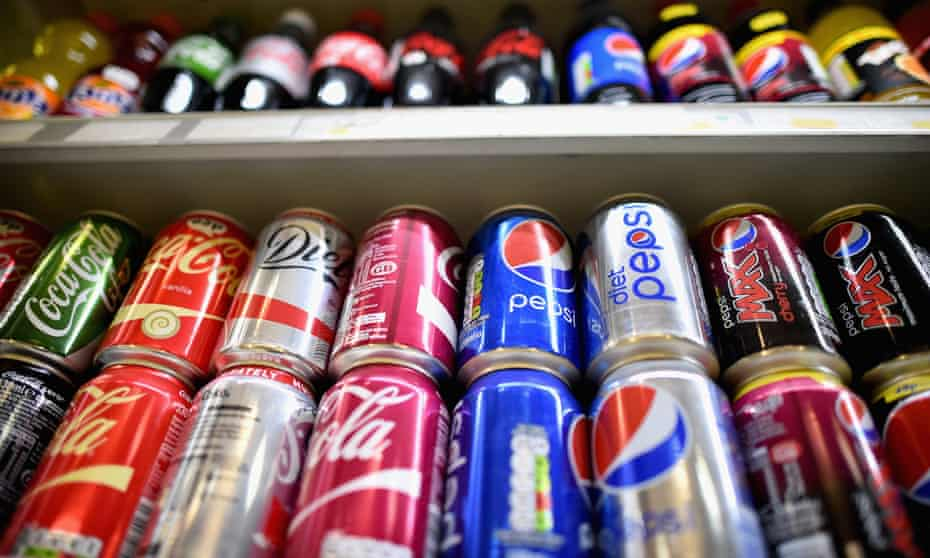 Fizzy drinks are stocked on a shelf in a shop in Glasgow