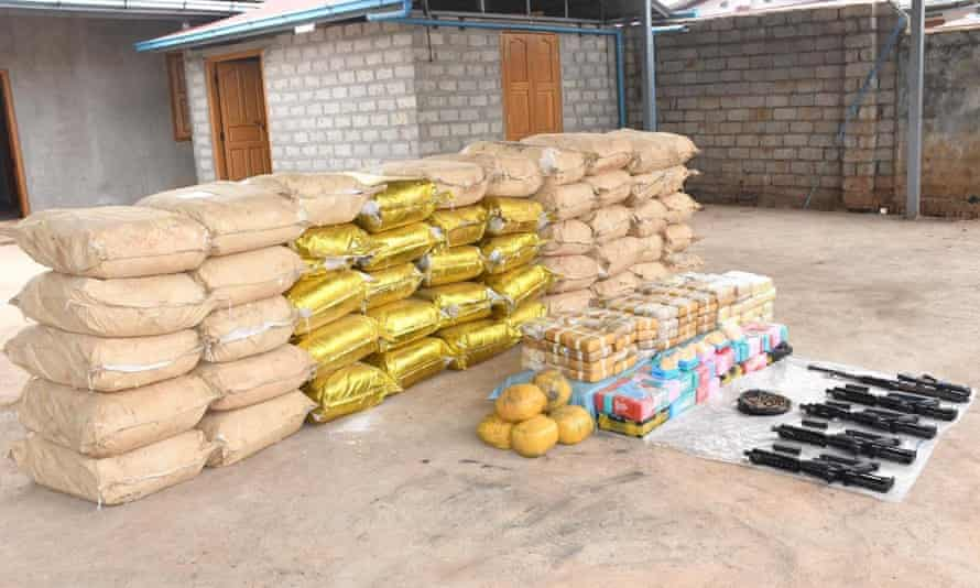 Weapons, ammunition and bags of crystal methamphetamine and meth-laced yaba pills seized by Myanmar police.