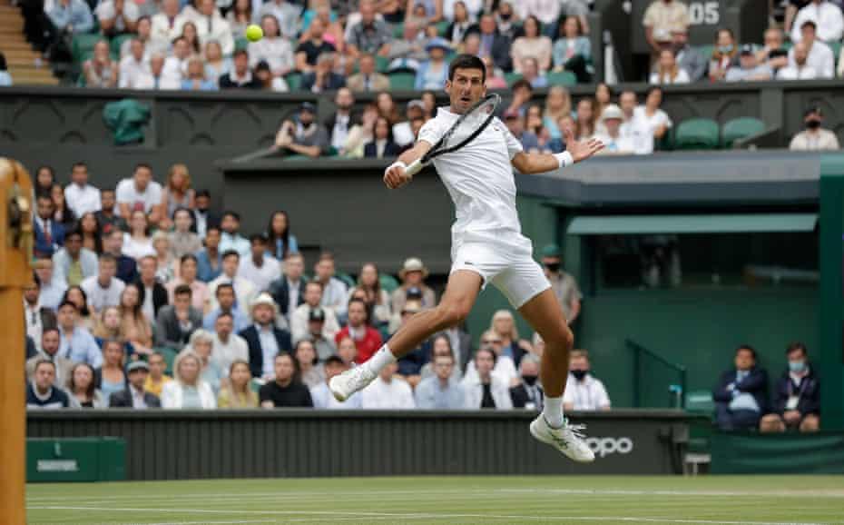 Novak Djokovic volleys a shot back to Denis Shapolavov.