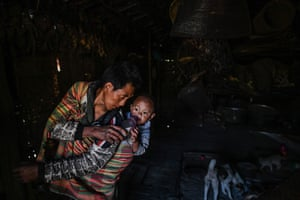 It is tradition for the men of the village to look after the children while the women collect the wood.