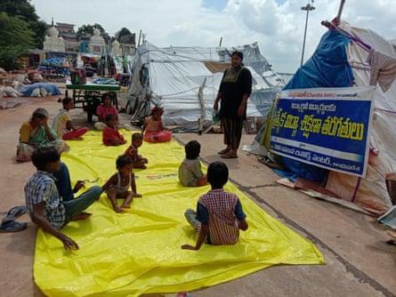 Students at a temporary outdoor learning centre in Vijayawada, Andhra Pradesh.