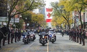 The funeral procession for Cpl. Nathan Cirillo approaches the Christ's Church Cathedral on October 28, 2014 in Hamilton, Ontario, Canada. Cirillo was shot and killed while on duty at Parliament Hill in Ottawa by Michael Zehaf-Bibeau on October 22. (Photo by Aaron Vincent Elkaim/Getty Images)
