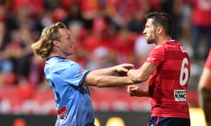 Rhyan Grant of Sydney and Vince Lia of United clash during the FFA Cup Final match between Adelaide United and Sydney FC.