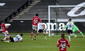 Bristol City's Nahki Wells (left) scores his side's equaliser.