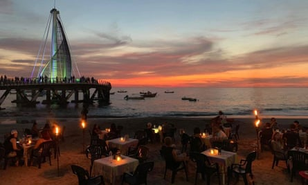 Cuates y Cuetes Mexico beach bar with sunset, sea and tower