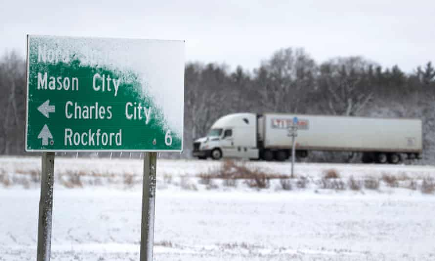 A truck travels along Highway 18 near Rudd, Iowa. Some experts are concerned trucking companies are underestimating the time and costs to make this technology transition.
