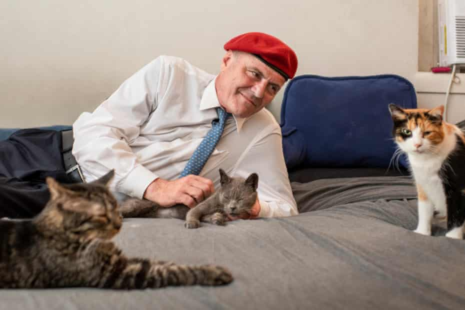 Curtis Sliwa, founder of The Guardian Angels and Republican candidate for Mayor of New York, at home with three of fifteen cats. 7/27/21 New York , New York Ali Smith for The Guardian