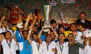 Sevilla lift the Europa League trophy after their 3-1 win over Liverpool in Basel.
