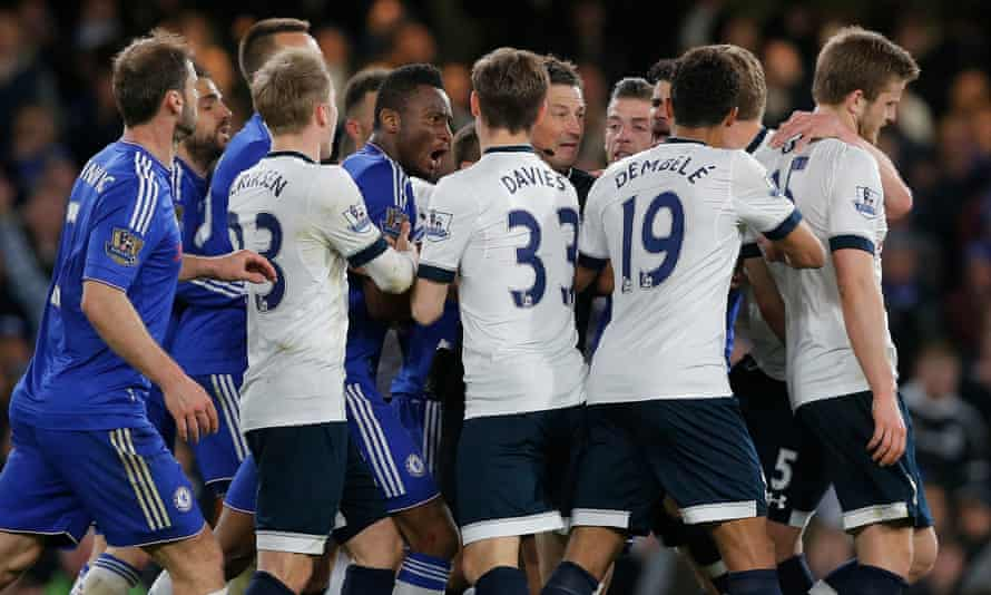 The Chelsea and Tottenham players surround Mark Clattenberg during one of many flashpoints in a bad-tempered game which ended with Spurs surrendering the title.