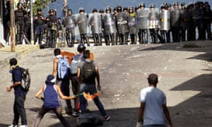 Demonstrators clash with riot police during a rally to demand a referendum to remove Nicolas Maduro in San Cristobal, Venezuela on 24 October 2016.