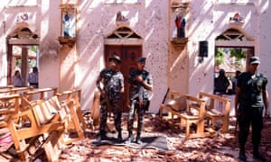 Sri Lankan soldiers inside the St Sebastian's Church at Katuwapitiya in Negombo
