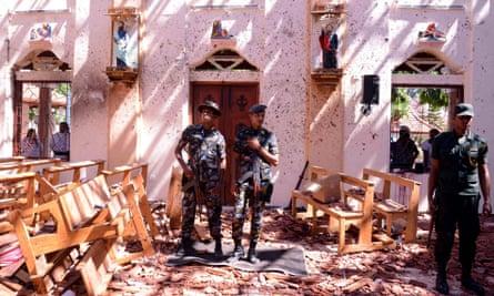 Sri Lankan soldiers inside the St Sebastian's Church at Katuwapitiya in Negombo
