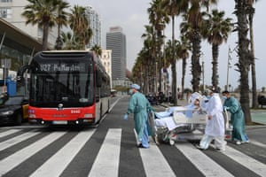 Barcelona, SpainMedical personnel of Hospital del Mar take a coronavirus patient, Marta Pascual, 72, back to the hospital after getting some fresh air by the sea, at the Barceloneta beach esplanade