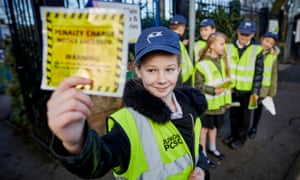 Brook Busby, aged 10, working as a junior PCSO outside Russell Scott primary school in Denton, Manchester